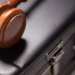 gavel and brief case, commercial litigation theme