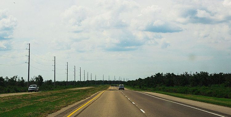 motor vehicles driving down an open road